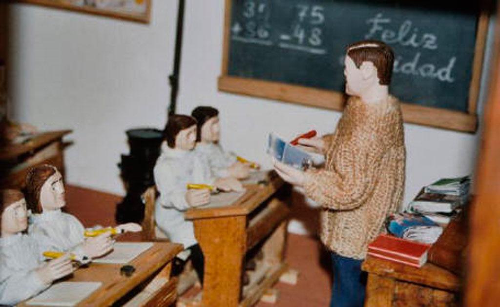 El profesor y los niños en la escuela.